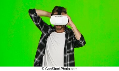 Man from something deviates in VR mask. Green screen - Man...