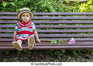 Sad toddler sitting on a bench - Cute sitting on a bench...