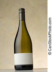 Chardonnay wine bottle with blank label sitting on stone...