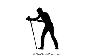 Lifting the camera on a tripod Silhouette on white...