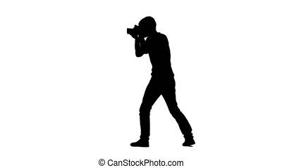 Photographer in process calls up someone and showing...