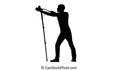 Using the camera on tripod at eye level. Silhouette. White -...