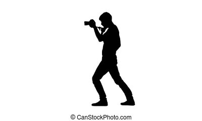 Man works in studio and makes videotaping. Silhouette. White...