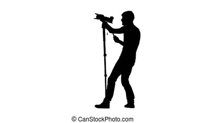 Conducting recording by camera on a tripod. Silhouette....