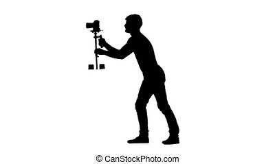 Videography by camera on Steadicam installation. Silhouette....