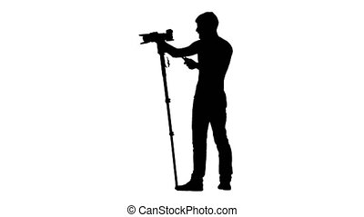 Camera on tripod at eye level of man. Silhouette. White -...