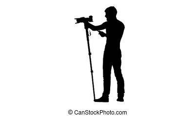 Camera on tripod at eye level of man. Silhouette. White -...