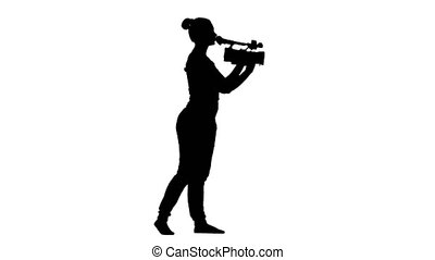 Operator makes the video camera turning. Silhouette, white background