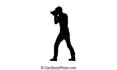 Photographer works showing gestures what to do. Silhouette, white background