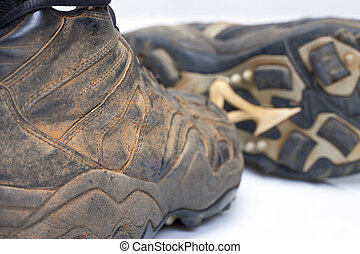 Baseball Cleats - Used baseball cleats against a white...