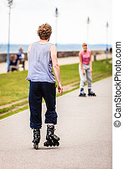 Active young people friends rollerskating - Active people...