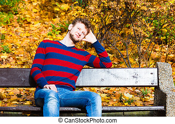 man sitting on the bench in park