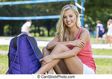 Blonde Model Outdoors - A blonde model posing in an outdoor...