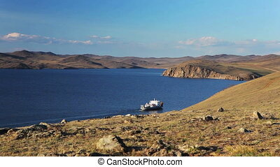 Ferry go lake Baikal in a summer day to olkhon island Moving...