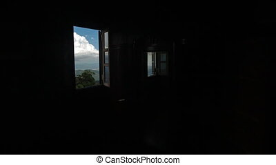 Camera Moves away from Landscape through Window to Room