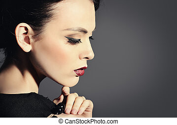 girl in profile - Portrait of a beautiful brunette model....