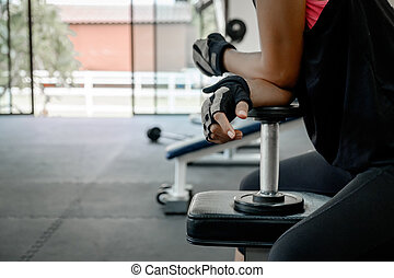 athletic young woman doing a fitness workout with dumbbell