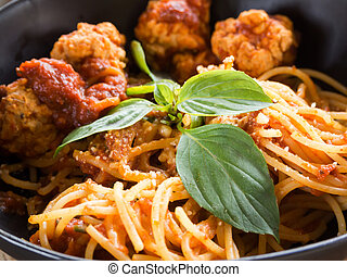 Closeup spaghetti pasta with meatballs and tomato sauce