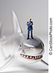 hes a shark - Business figurines placed with a shark...