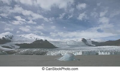 Time lapse glacier on Iceland A small iceberg is turning and...