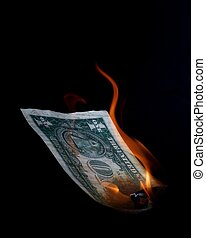 The fall of the dollar - An American dollar banknote burning...
