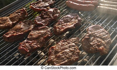 Pork meat and sausages on BBQ grill - Pork meat and sausages...