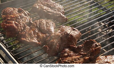 Rotate pork on a barbecue grill - Rotate pork with grill...