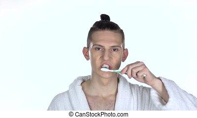 Man brushing his teeth. Isolated on white background. Slow motion