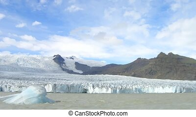 Time lapse glacier on Iceland. A small iceberg is turning...