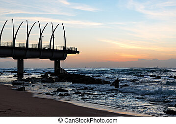 Pier in Umhlanga Rocks at Sunrise - Man performing religious...