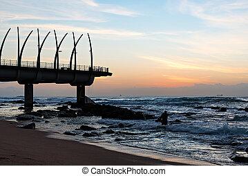 Pier in Umhlanga Rocks at Sunrise - Man performing religious...