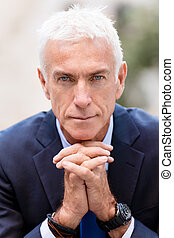 Portrait of confident businessman outdoors - Portrait of...
