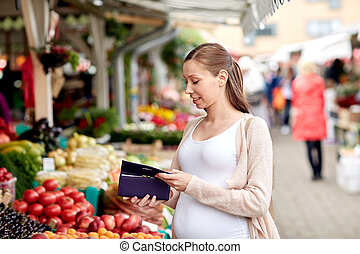 pregnant woman with wallet buying food at market - sale,...