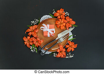 Festive table setting - Terracotta plate decorated with...