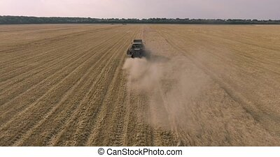 harvester on the wheat field from the aerial survey