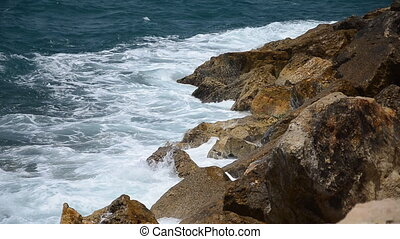 Sea waves crashing on the rocks