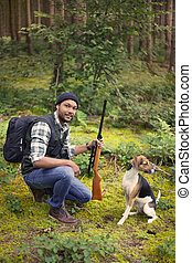 Interracial hunter in the forest with his dog