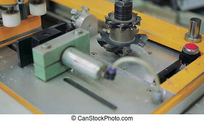 Close-up milling cutter on the production machine at factory...