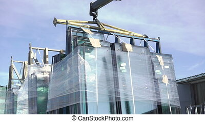 Loading window glass on the vehicle from window factory 4K.