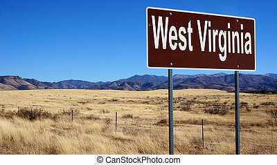 West Virginia road sign with blue sky and wilderness