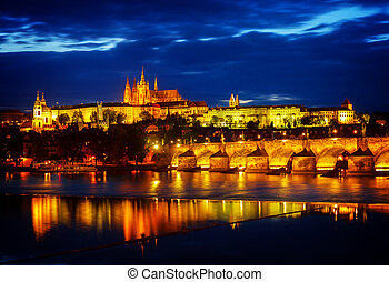 skyline of Prague with Vitus cathedral and Charles bridge at...