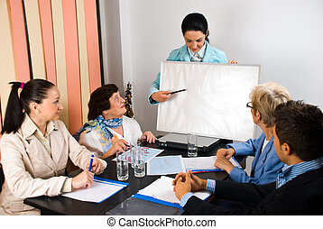 Presentation on board at business meeting - Business woman...