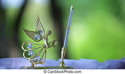 gold holder for pens. - gold pen stand with an angel