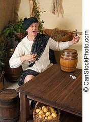 Funny Scotsman drinking whisky