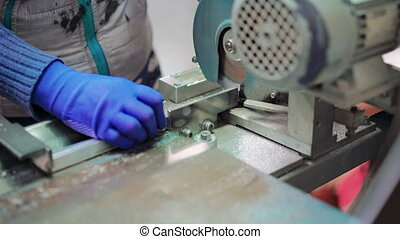 Close-up hands working with metal profiles and production...