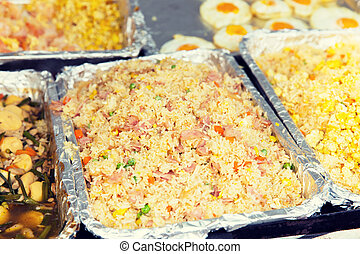 wok or pilaf dish at street market - cooking, asian kitchen,...