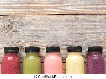 Assorted fruit smoothies background with space