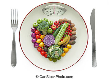 Healthy diet concept - Plate with weighing scales packed...