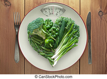 Green healthy diet concept - Plate with weighing scales...