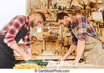 carpenters with blueprint at workshop - profession,...
